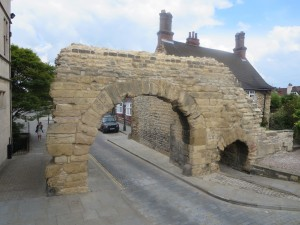 Newport Arch at the Lincolnshire IA tour of Lincoln on the City of Lincoln open top bus on 8th July 2014