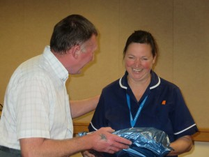 Lincolnshire IA Autumn Meeting Saturday 15th November 2014. Chairman Fred Coper presenting Mrs Jocelyn Fizgerald with an Anitomycal Training Apron donated to the Colorectal Department.