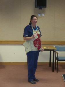 Lincolnshire IA Autumn Meeting Saturday 15th November 2014. Lincolnshire IA President Mrs Jocelyn Fitzgerald demonstrating the new teaching apron