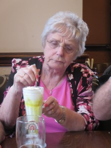 Edna Staniland tucking into her pudding