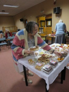 Sue McGlashen choosing off the buffet table
