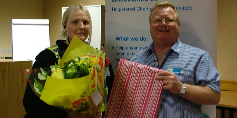 Paul Pyrah presents the speaker PCSO Kat Bannister with abouquet and chocolates